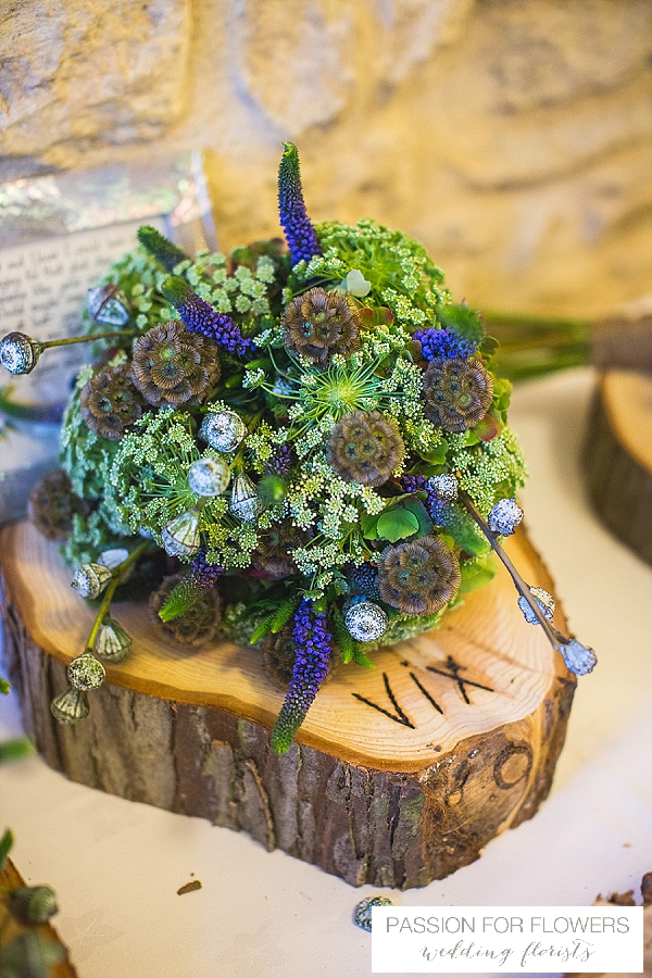 blue green wedding bouquet on tree slice flowers passion for flowers