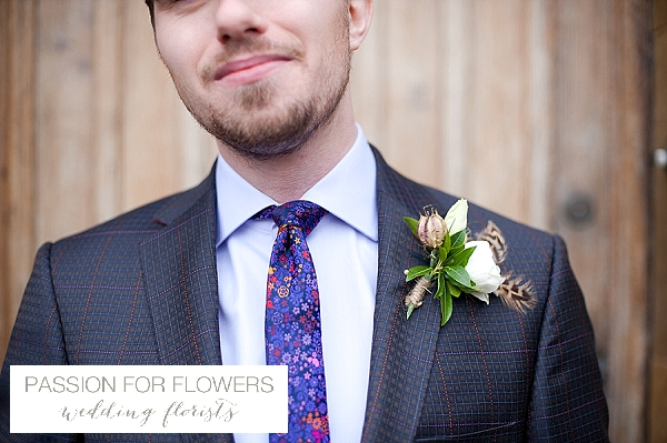 wedding buttonholes feathers twine