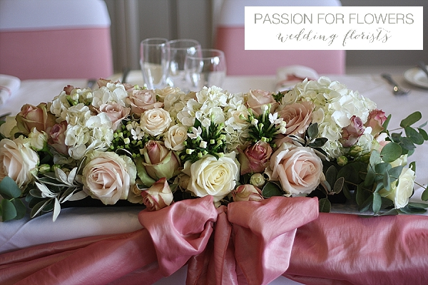 dusky pink top table wedding flowers