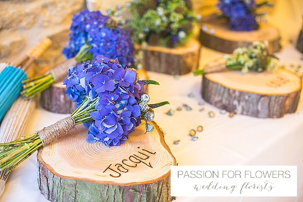 kingscote barn blue wedding bouquets on tree slices