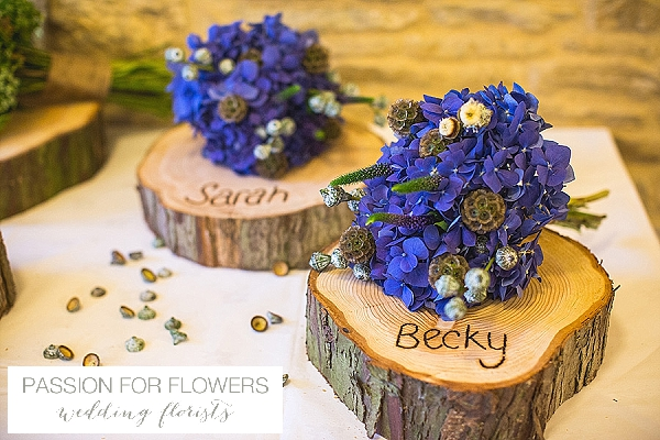 kingscote barn wedding bouquets on tree slices
