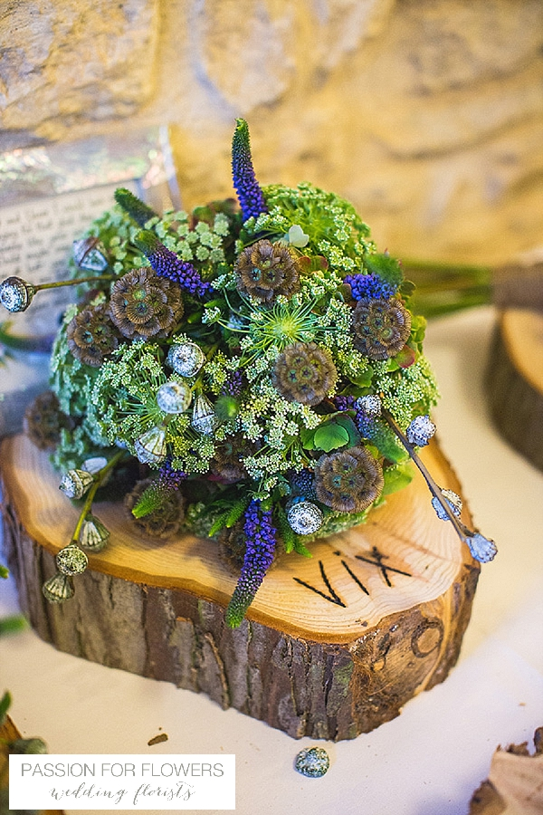kingscote barn wedding bridal bouquets on wooden tree slice