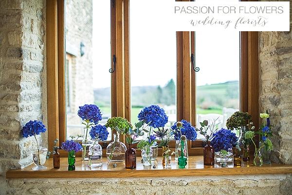 kingscote barn blue bottles wedding flowers
