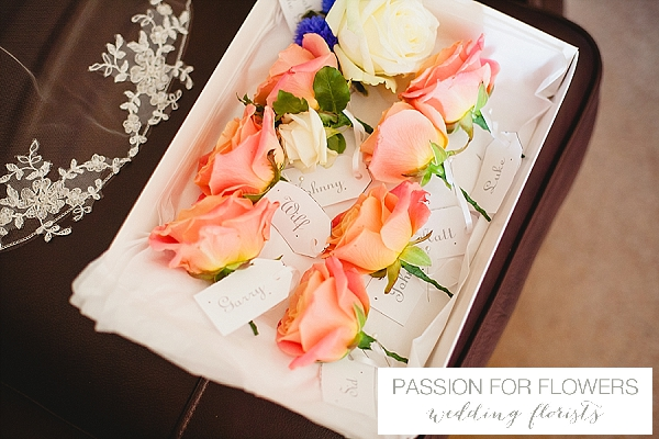 coral buttonholes wedding flowers