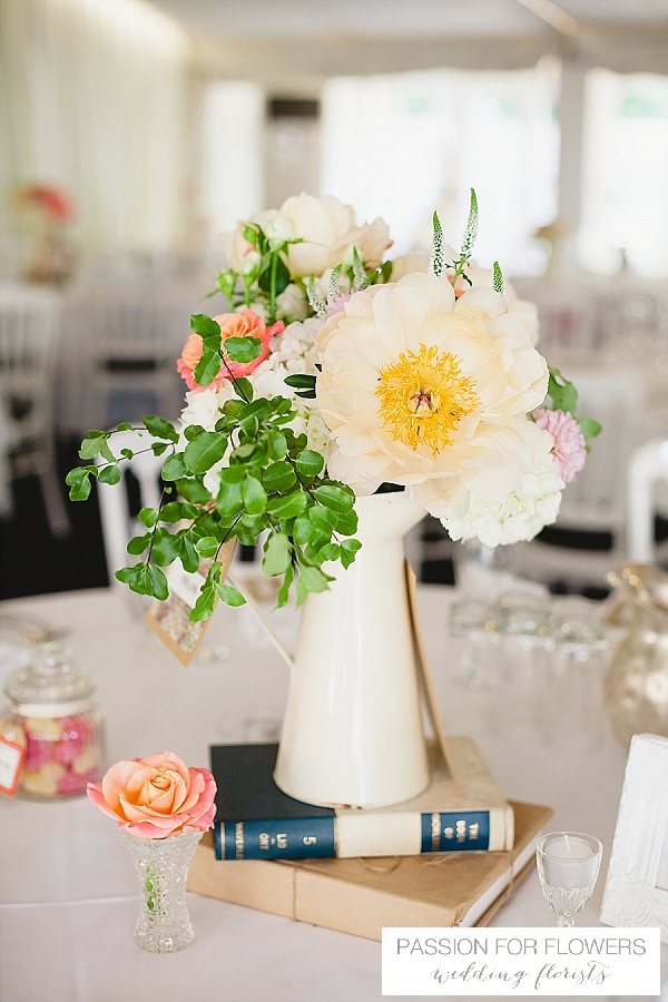 moxhull hall wedding centrepieces jugs with coral peonies flowers