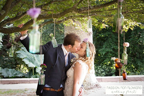 hanging flowers in bottles from trees wedding flowers passion for flowers wedding florists