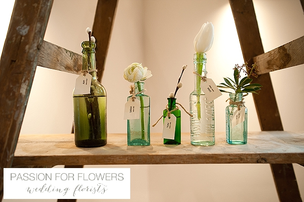 the moat house dorsington escort cards on bottles on ladders wedding flowers