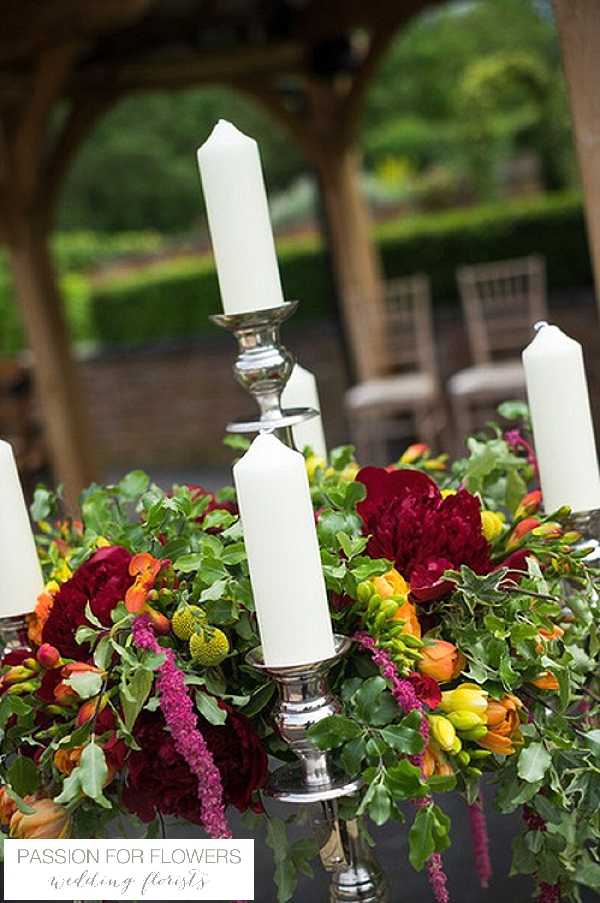 bright wedding flowers candelabra