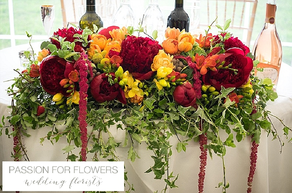 bright pink orange wedding flowers peonies ranunculus indian wedding