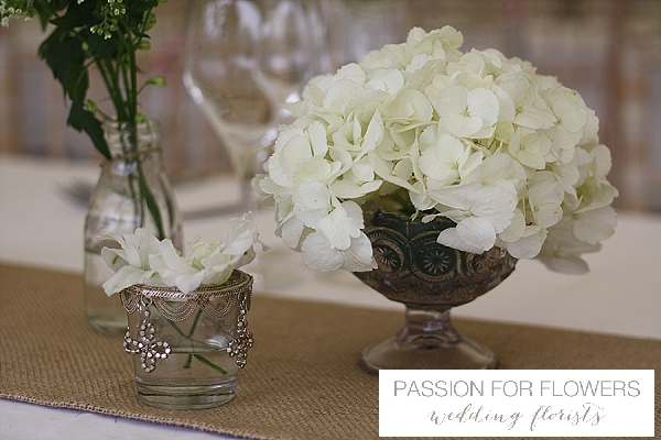 white wedding centrepiece in crystal bowls vases flowers passion for flowers