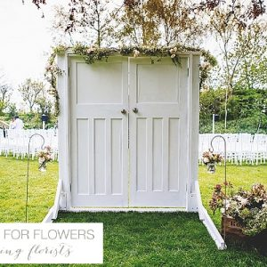 South farm wedding flowers wooden doors outdoor ceremony