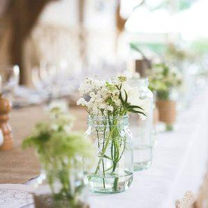 Cripps Barn Wedding Flowers In Jam JarsTop Table