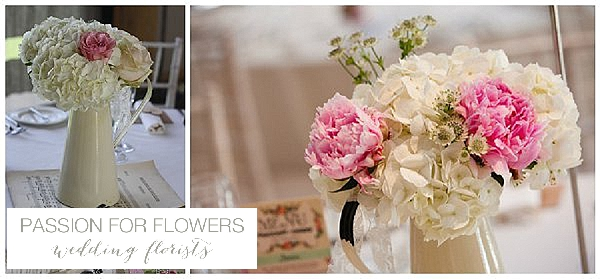 Redhouse barn wedding flowers  centrepieces jugs