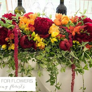 bright pink red orange wedding flowers sweetheart table indian wedding