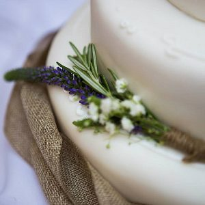 cripps barn wedding cake decorated with rustic hessian lavender