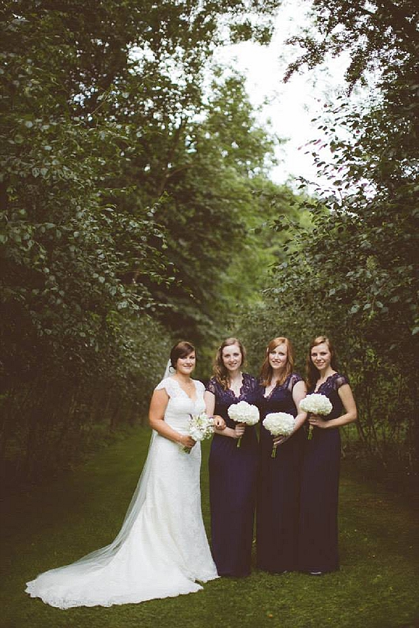 cripps barn wedding flowers bridesmaids navy dresses white hydrangea bouquets