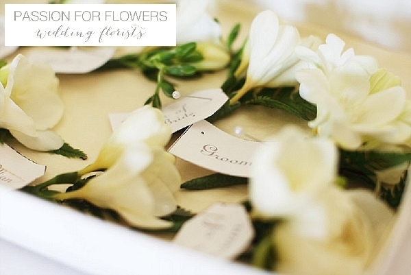 passion for flowers buttonholes with name tags wedding