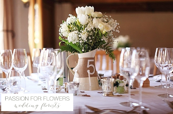 curradine barns wedding flowers  centrepieces jugs