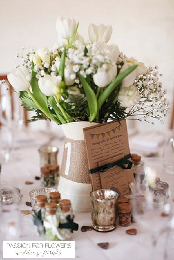curradine barns wedding centrepieces flowers in jugs