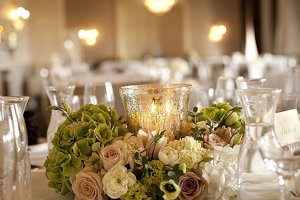 elegant wedding centrepiece flowers mercury silver hurricae vase ring of flowers nude roses green hydrangeas
