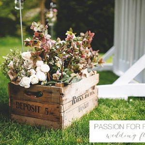 outdoor-wedding-ceremony-rustic-flowers-in-crates