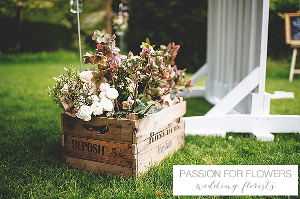 outdoor-wedding-ceremony-rustic-flowers-in-crates