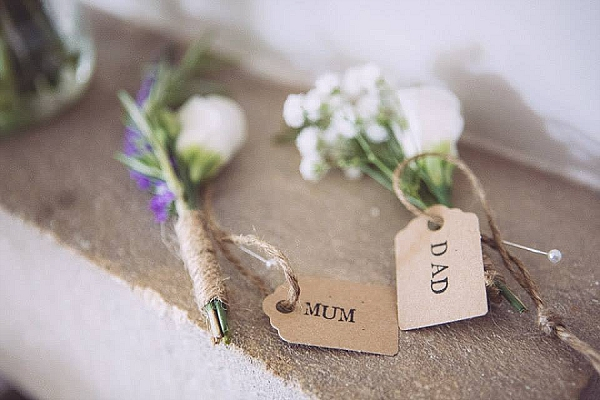 rustic wedding button holes with twine luggage tags names