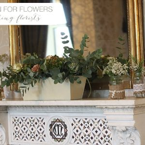 walton hall wedding mantle piece flowers