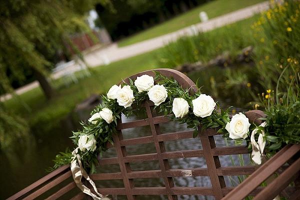 cream rose flower garland bench