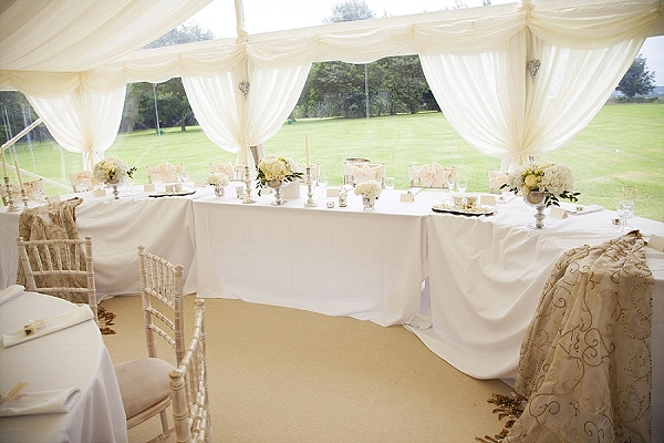 marquee top table wedding flowers cream roses hydrangeas footed vases