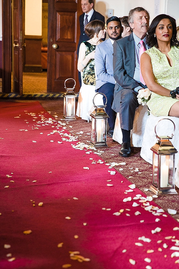 petals and silver lanterns down wedding aisle