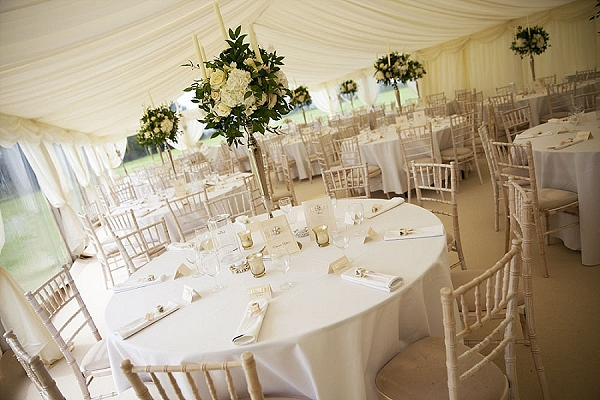 summer marquee wedding flowers tall candelabra cream roses elegant