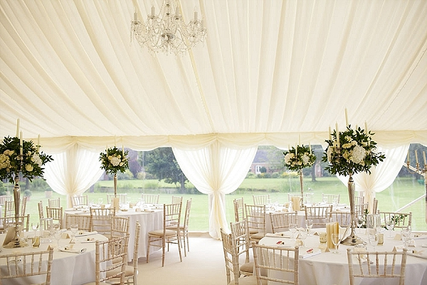 summer marquee weding flowers elegant candelabra white roses green ruscus