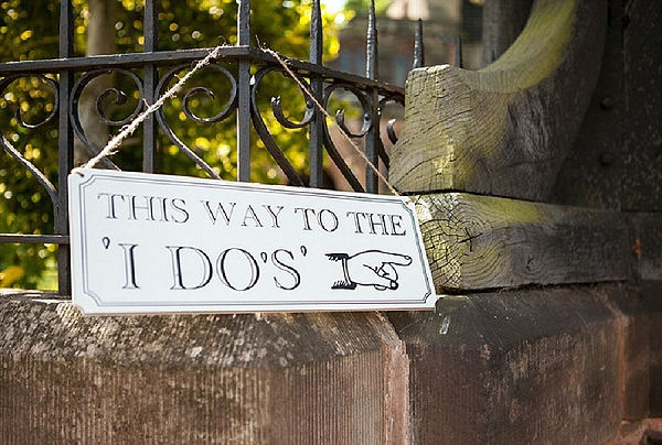 this way to the i dos wedding directional signs