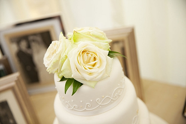 white avalanche rose wedding cake