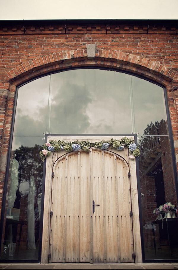 flower arch outside shustoke farm barns wedding flowers passion for flowers