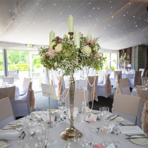 hogarths hotel wedding flowers candelabra tall centrepieces