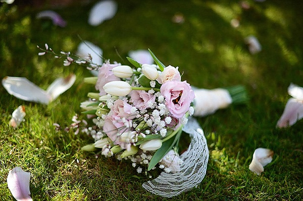 light pink lisianthus tulips gypsophila broom spring bridesmaids bouquets