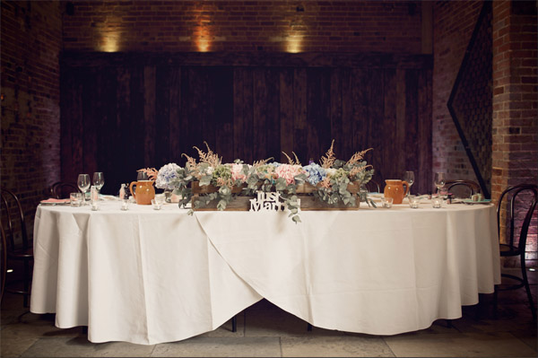 shustoke farm barns summer wedding top table florist passion for flowers blue pink rustic crates