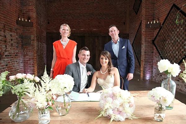 shustoke farm barns wedding ceremony table flowers passion for flowers pink cream wild rustic