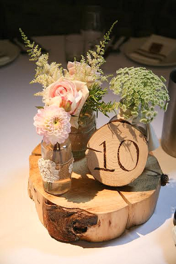 Rustic Wedding Centrepieces On Tree Slice Passion For Flowers