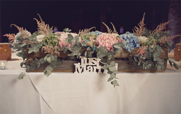 wooden crate box with flowers top table shustoke farm barns summer wedding florist passion for flowers