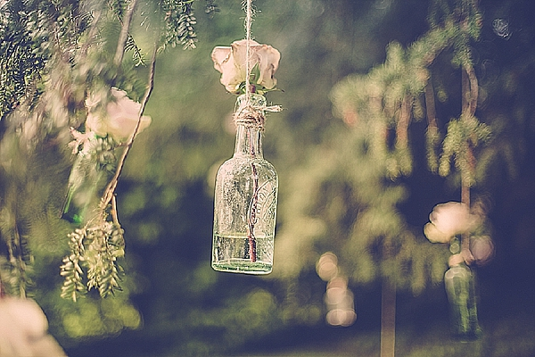 wroxall abbey wedding flowers vintage glamour hanging bottles with flowers