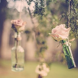 wroxall abbey wedding flowers vintage glamour hanging flowers in bottles outdoor wedding flowers