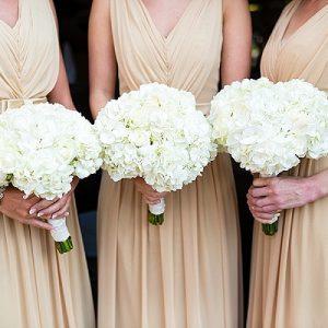 white bridesmaids bouquets white hydrangeas