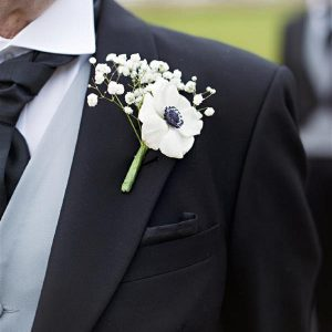 black-and-white-anemone-button-holes winter wonderland wedding