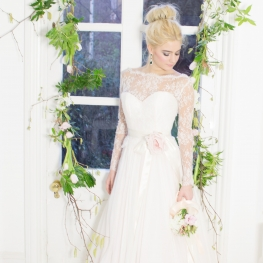 green foliage whimsical delicate floral garland archway wedding