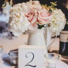 cream-jugs-centrepieces-passion-for-flowers-shustoke-farm-barns.jpg