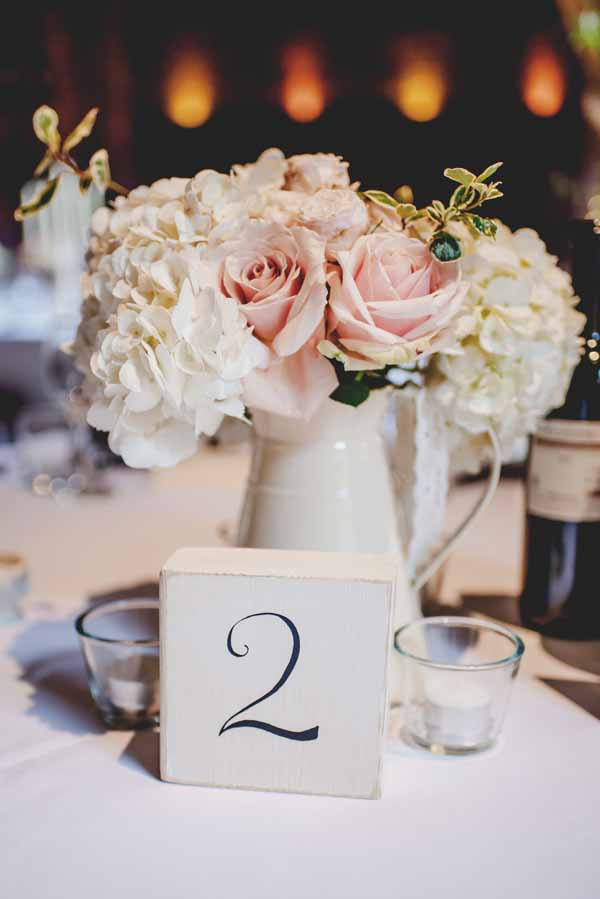 cream-jugs-centrepieces-passion-for-flowers-shustoke-farm-barns.-wedding