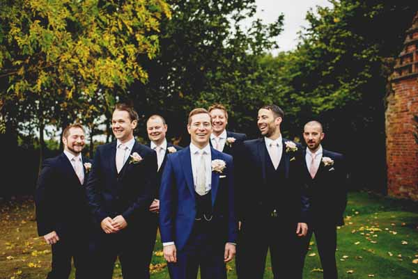 passion-for-flowers-shustoke-farm-barns-wedding-navy-suits-buttonhole